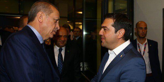WARSAW, POLAND - JULY 9: President of Turkey Recep Tayyip Erdogan speaks with Prime Minister of Greece...