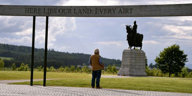 A man looks on at the historic battlefield site of Bannockburn on the eve of the battle's anniversary...