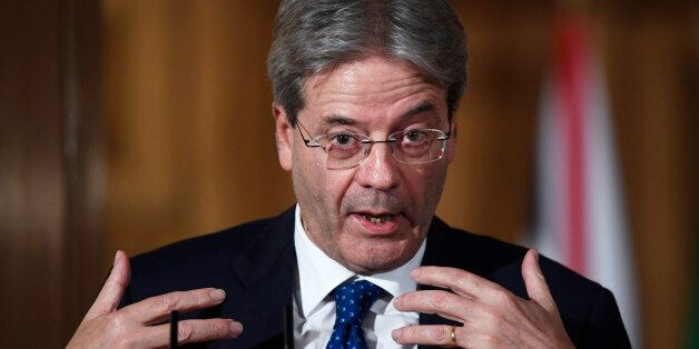 Italy's Prime Minister Paolo Gentiloni holds a press conference with his counterpart from Britain Theresa...