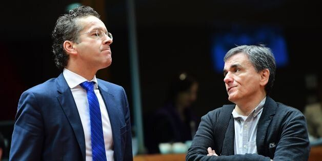 Eurogroup President and Dutch Finance Minister Jeroen Dijsselbloem (L) and Greece's Finance Minister...
