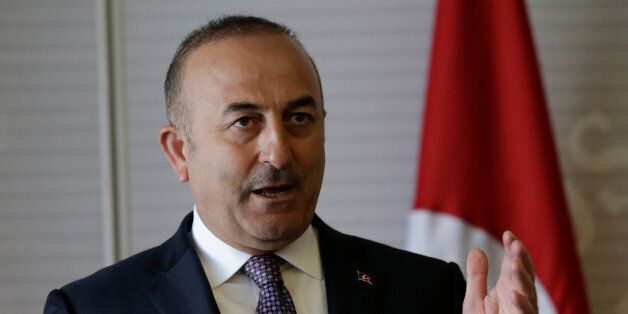 Turkish Foreign Minister Mevlut Cavusoglu gives a speech to the media at the foreign ministry building...
