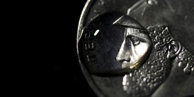 A drop of water is seen on a Greek twenty-Drachma coin depicting ancient Athenian politician and general...