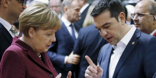 Germany's Chancellor Angela Merkel listens to Greece's Prime Minister Alexis Tsipras (R) during a European...