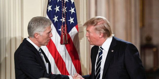 WASHINGTON, DC - JANUARY 31: President Trump shakes the hand of Judge Neil Gorsuch during a Supreme Court...