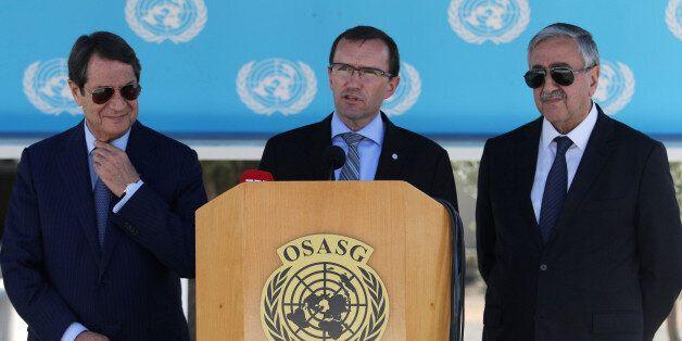 U.N. envoy Espen Barth Eide (C) speaks to the media next to Greek Cypriot leader and Cyprus President...