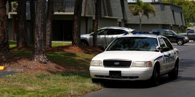 A police car is pictured in front of Omar Mateen's home in Port Saint Lucie, Florida, U.S. June 14, 2016....