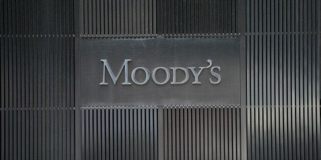 A sign for Moody's rating agency is displayed at the company headquarters in New York, September 18,...