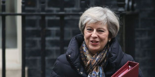 Britain's Prime Minister Theresa May leaves 10 Downing Street in central London on January 25, 2017 to...