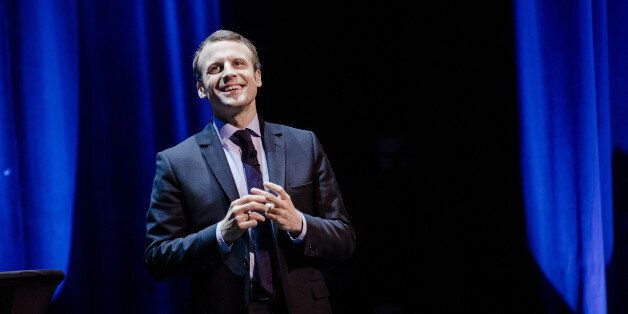 Emmanuel Macron, French presidential candidate, reacts on stage during a campaign event in Paris, France,...