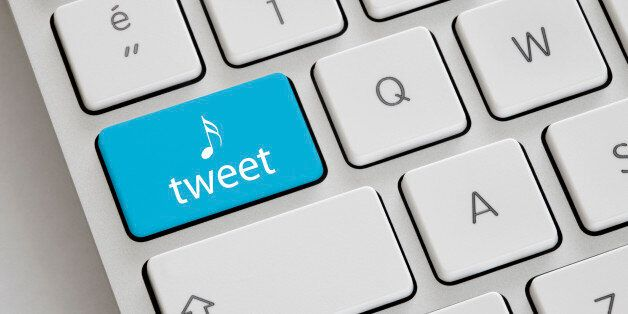 Blue coloured 'Tweet' button on a keyboard.