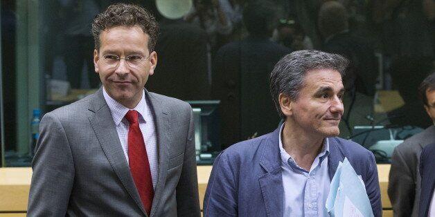 Newly appointed Greek Finance Minister Euclid Tsakalotos (R) and Eurogroup President Jeroen Dijsselbloem...