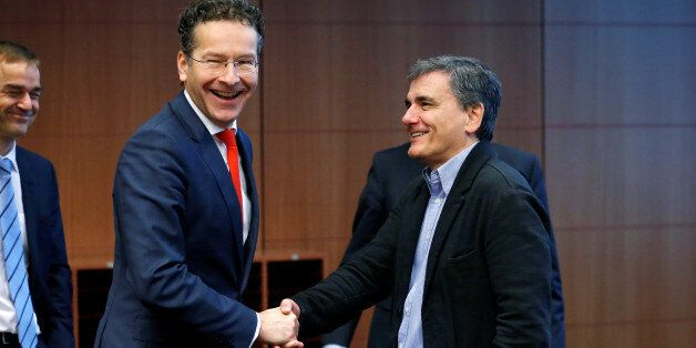 Dutch Finance Minister and Eurogroup President Jeroen Dijsselbloem greets Greek Finance Minister Euclid...