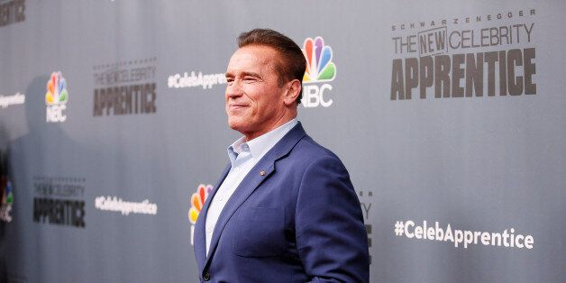 Host Arnold Schwarzenegger poses after a panel