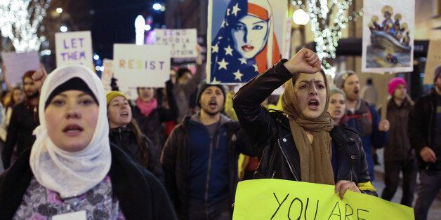 People march through downtown Seattle during a protest held in response to President Donald Trump's travel...