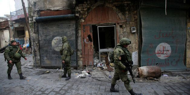 Russian soldiers walk in the Old City of Aleppo, Syria January 31, 2017. REUTERS/Ali