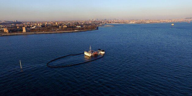 ISTANBUL, TURKEY - FEBRUARY 01: Sorbent boom circle to control spreading the pollution after a Tanzanian...
