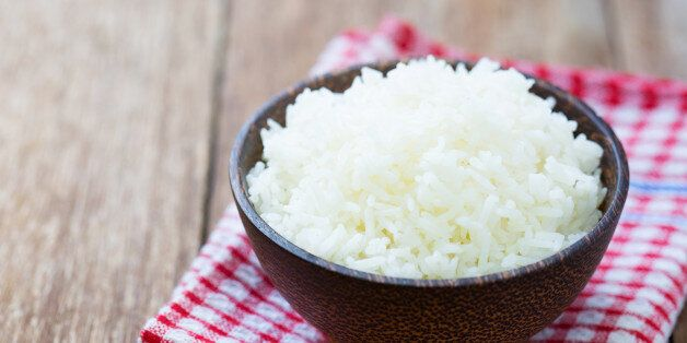 Jasmine rice in a rice bowl on wood