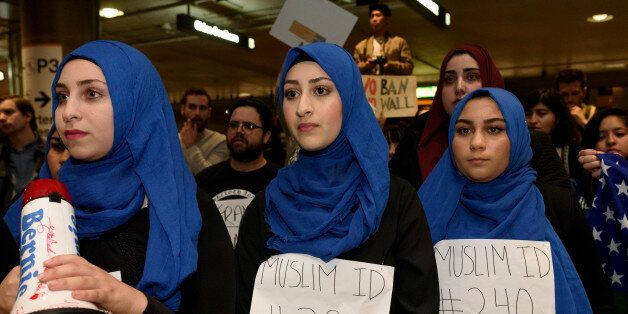 Demonstrators at Los Angeles International Airport protest against President Trump's executive order...