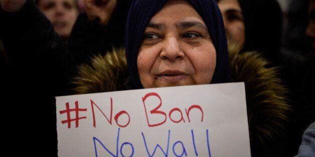 A Muslim women holds a sign during anti-Donald Trump travel ban protests outside Philadelphia International...