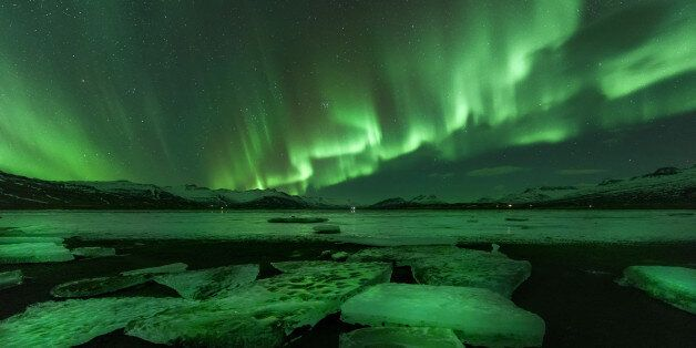 Northern lights (Aurora borealis) reflection across a lake in