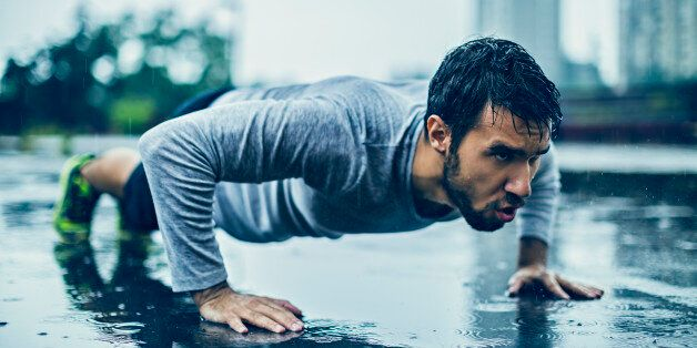 Picture of a young athletic man out exercising in the rain