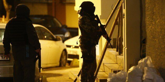 Members of police special forces take part in an operation near the police headquaters after an attack...