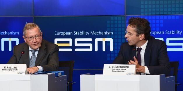 European Stability Mechanism (ESM) Managing Director Klaus Regling (L) and Dutch Finance Minister and...