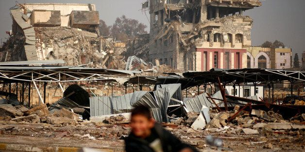 Buildings destroyed during previous clashes are seen as Iraqi forces battle with Islamic State militants...