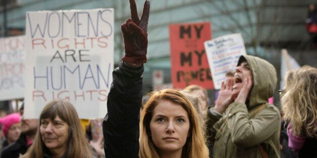 VANCOUVER, Jan. 21, 2017 : People attend the Women's March to protest against U.S. President Donald Trump's...