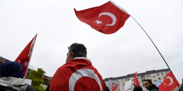 Turkish flags during a protest meeting outside the Bredangsskolan school in southern Stockholm, Sweden,...
