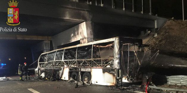 A charred bus, which was carrying Hungarian students, is seen on a side of a highway, near Verona, northern...