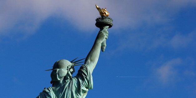The Statue of Liberty is seen on the 130th anniversary of the dedication in New York Harbor, in New York...