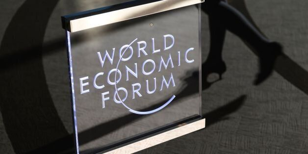 A woman enters the World Economic Forum on the closing day of the forum, on January 20, 2017 in Davos....