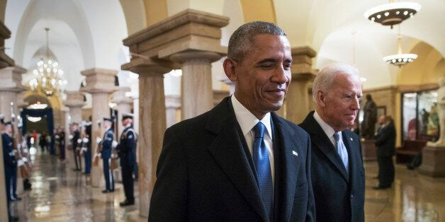 President Barack Obama and Vice President Joe Biden walk through the Crypt of the Capitol for Donald...
