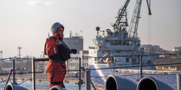 A soldier stands guard on the Turkish boat TCG Turgutreis in the port of Varna, March 9, 2015. NATO ships...