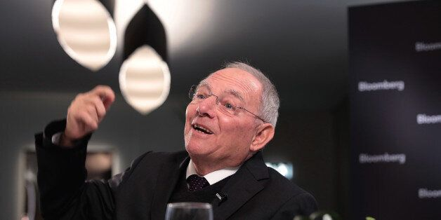 Wolfgang Schaeuble, Germany's finance minister, gestures as he speaks during a Bloomberg Television interview...