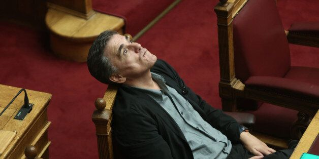 Greek Finance Minister Euclid Tsakalotos during the debate at the Greek Parliament on the Omnibus Bill...