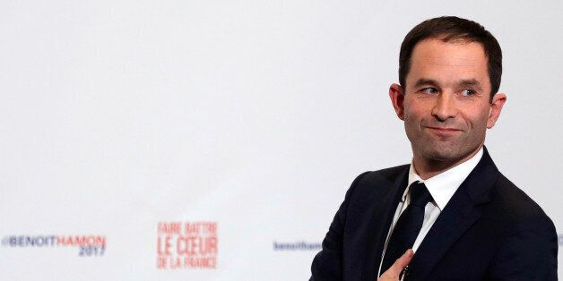 Former French education minister Benoit Hamon reacts after partial results in the second round of the...