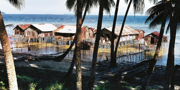 PAPUA NEW GUINEA - FEBRUARY 9: Palm trees and pile dwellings, Biak island, Papua New Guinea. (Photo by...