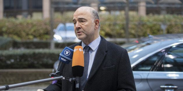 Pierre Moscovici, economic commissioner for the European Union (EU), speaks to members of the media as...