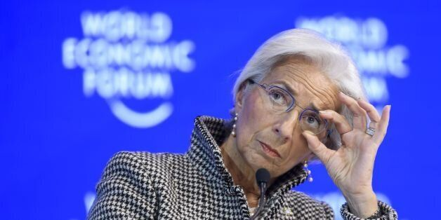 International Monetary Fund (IMF) managing director Christine Lagarde adjusts her glasses as she attends...