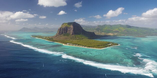 Mauritius island from helicopter. View on Le Morne mount and One Eye surf spot. Place with biggest waves...