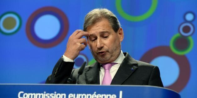 European Union Commissioner for Enlargement Johannes Hahn gestures as he talks to the media at the European...