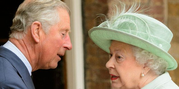 Britain's Queen Elizabeth is greeted by her son Prince Charles, as she arrives to attend a service for...