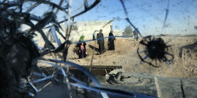TOPSHOT - A picture taken through the bullet-riddled windshield of an Iraqi Special Forces armoured vehicle...