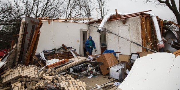 A heavily damaged residence is seen December 27, 2015 in the aftermath of a tornado in Rowlett, Texas....