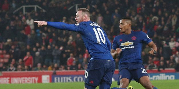 STOKE ON TRENT, ENGLAND - JANUARY 21: Wayne Rooney of Manchester United celebrates scoring their first...