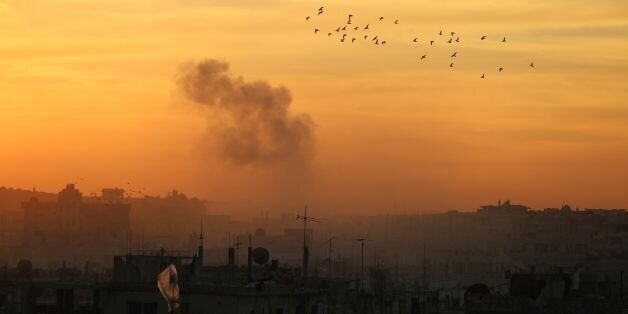 TOPSHOT - Smoke billows from a rebel-held area of Daraa, in southern Syria, following reported shelling...