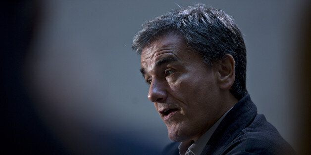 Euclid Tsakalotos, Greece's finance minister, speaks during a Bloomberg Television interview at the International...