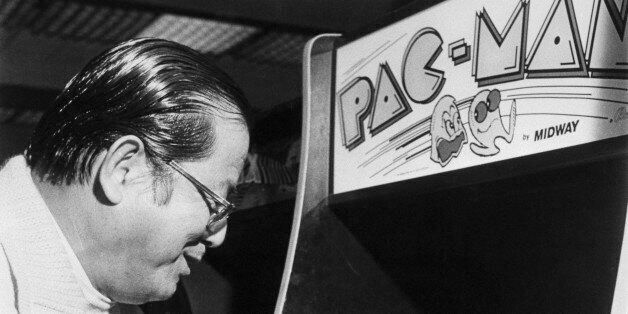 (Original Caption) Masaya Nakamura, father of the popular video arcade game, takes a turn at Pac-Man....